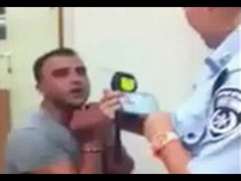 Israeli Man Goes Nuts After Being Detained By Police For DUI (Repeatedly Bangs His Head On Wall) .